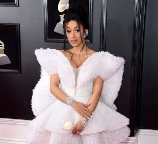 "Did Cardi B Win A Grammy Award? - 2018 Nominations  Cardi B did not win a Grammy Award. Her hit song ""Bodak Yellow"" was nominated for Best Rap Performance and Best Rap Song. The video at the end of this article shows Cardi Hillary Clinton John Legend Cher Snoop Dogg and DJ Khaled each read an excerpt from Michael Wolff's bombshell book Fire and Fury: Inside the Trump White House.  Best Rap Performance  Kendrick Lamar's ""HUMBLE."" won the Grammy for Best Rap Performance. He beat out Cardi's…"