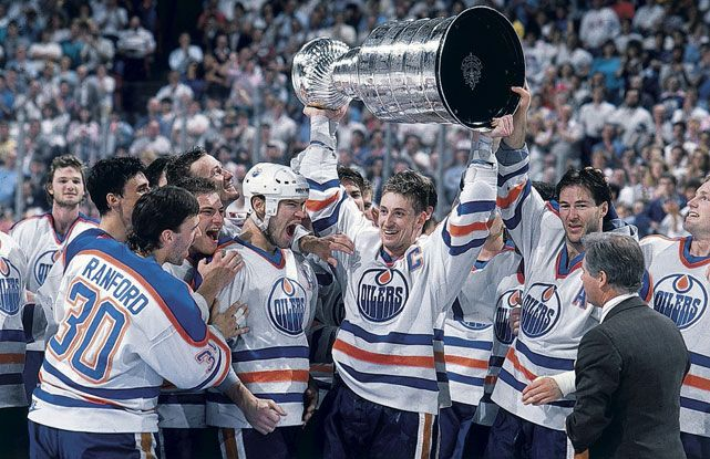 Wayne Gretzky is all smiles as Bill Ranford, Esa Tikkanen, Mark Messier, and Kevin Lowe look on after Edmonton defeated Boston in five games to claim the 1988 Stanley Cup.