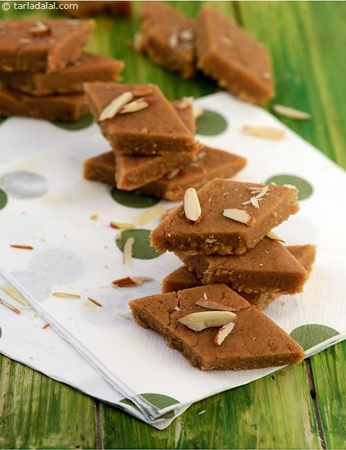 Golpapdi also known as sukhdi is a traditional Gujarati sweet made from whole wheat flour and jaggery. Cardamom and desiccated coconut add to the taste and flavour. Serve garnished with almond slivers.