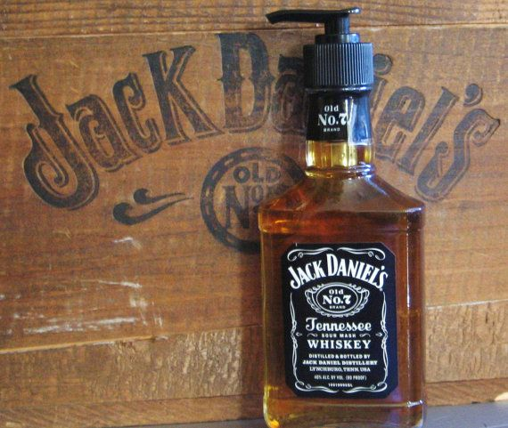 From empty Jack Daniel's bottle to soap container! (Most twist top glass bottles fit the standard soap dispenser top!)