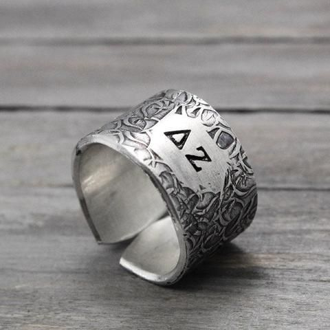 This charming hand stamped Delta Zeta ring will keep your letters close. The ring is hand textured with a abstract flower design, with your letters stamped in the center. Features & Measurements: ♥ 14