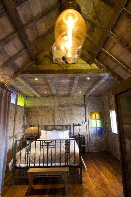 English vintage bed in cabin at Roemah Peranakan Bali