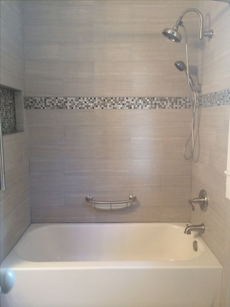 Tile tub surround. Gray tile around bathtub. Grey tile around bathtub.