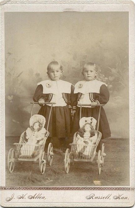 Twin sisters have twin doll and prams