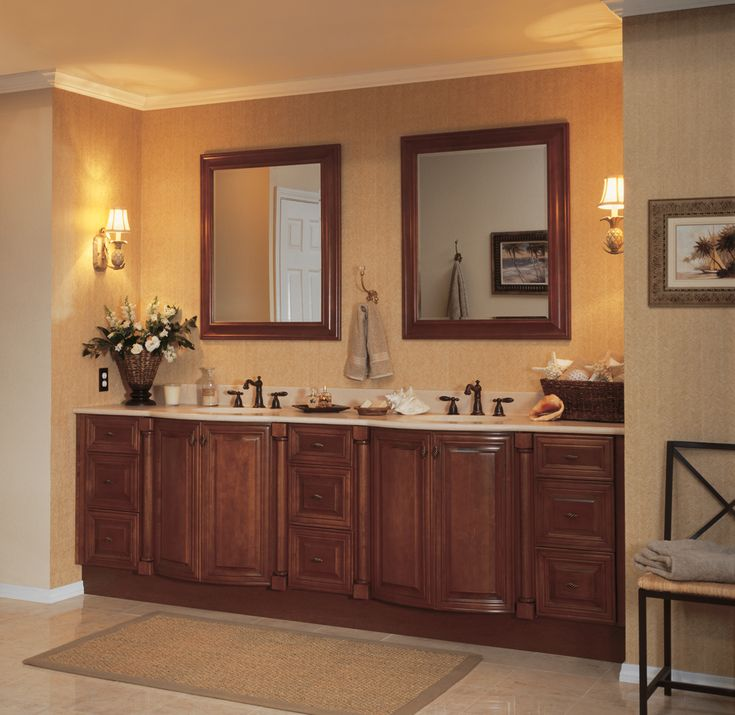 raised panel cognac bathroom cabinets with large mirrors