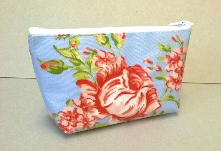 Make up bag in blue with pink flowers, Oilcloth cosmetic bag, ladies make up storage, wash bag, make up case, floral bag by KernowClaire on Etsy