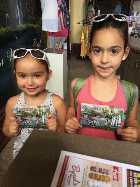 This is Abiella and Gali, all smiles.  They came all the way from Israel to the Savannah Visitor Center — And they nabbed a free post card.