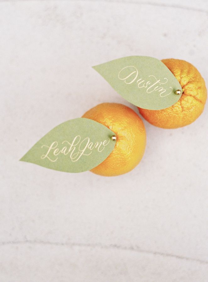 Citrusy escort cards: http://www.stylemepretty.com/north-carolina-weddings/charlotte/2016/05/13/its-all-about-the-dress-but-this-groom-brought-his-style-a-game/   Photography: Allison Kuhn - http://www.allisonkuhnphotography.com/
