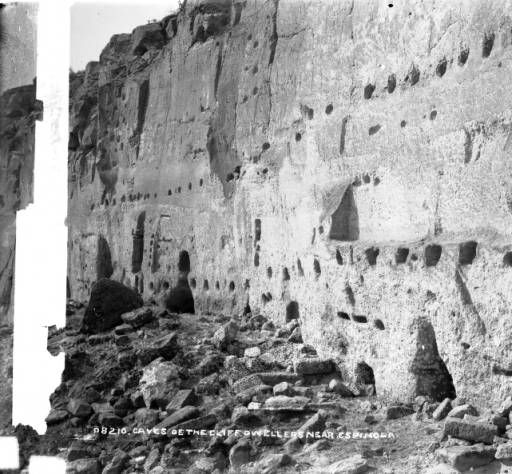 Caves of the cliff dwellers near Espanola.Creator(s):Jackson, William Henry, 1843-1942.View of ancient Native American (Anasazi) cliff dwelling ruins near Espanola (Rio Arriba County), New Mexico. Portions of the ruins have holes for vigas.