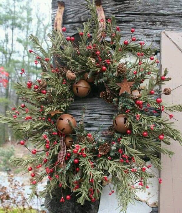 Prim Pine & Berry Wreath...with rusted stars and bells...hanging from a horseshoe.
