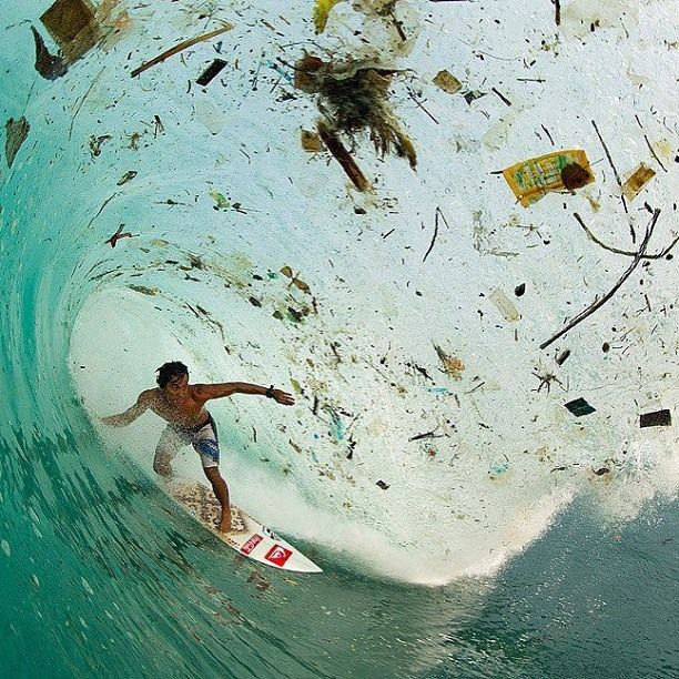 This photo is gnarly on so many levels. Indonesia has been a mecca for surfing for 40 years & in that time seasoned surf travelers have seen major changes. Some good, many bad. Here Dede Suryana shoots through a barrel choked with rubbish washed out from land.