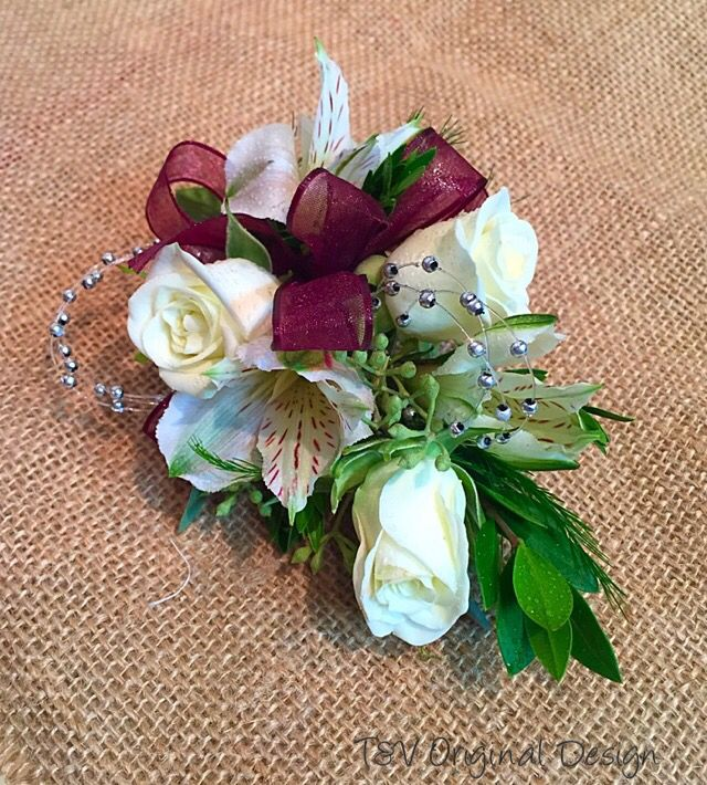 Maroon and white homecoming corsage.
