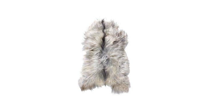 Ekologiskt garvat lammskinn från Island. Med det mjuka Kattla-lammskinnet får du in en bit av Islands tuffa natur i vardagsrummet. Kattla finns även som kudde till din fåtölj.