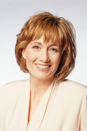 Senior Businesswoman in Short Haircut with Fringes