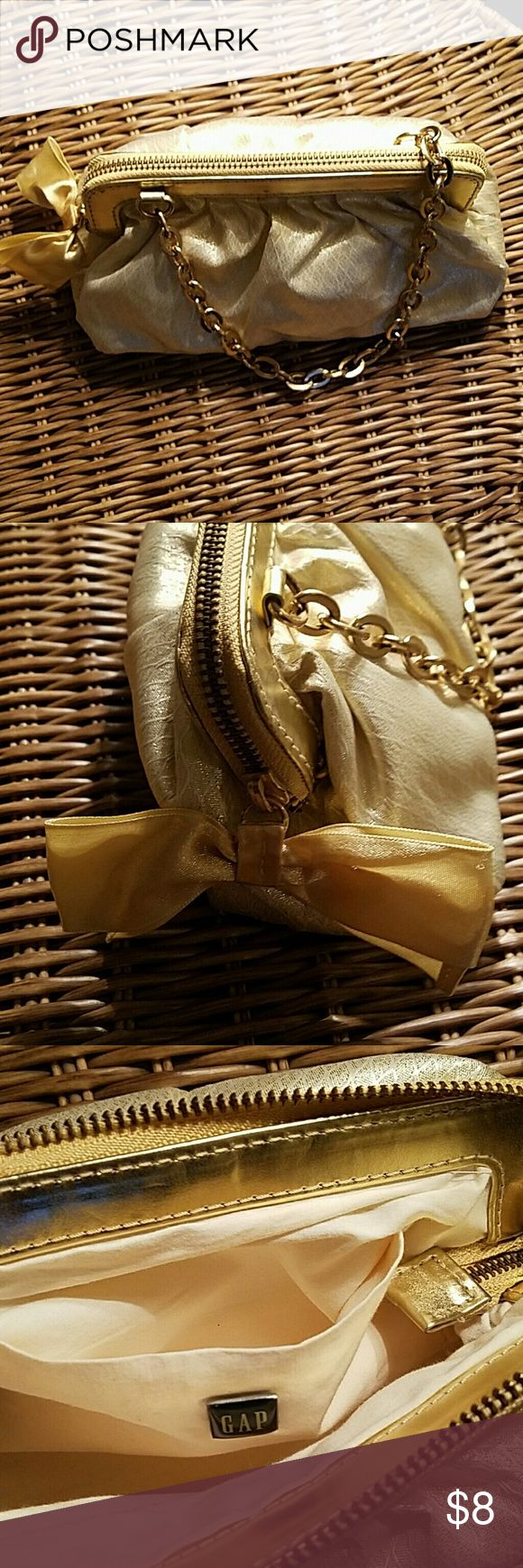 GAP Shimmering Gold Fabric Bag [NWOT] Gold hardware and of fabric material. Gold satin bow as zipper slider. Light weight.  Brand new / Never used. Excellent condition!  Perfect bag for a night out! GAP Bags Mini Bags