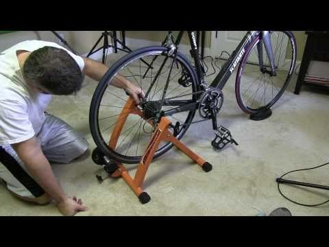 Conquer Indoor Bicycle Cycling Trainer Exercise Stand Setup.  This is how to setup the Conquer cycling trainer.  This is an awesome and affordable indoor bicycle trainer that I purchased from Amazon.com .  Please share this video.  Filmed with Canon XA10 camera.