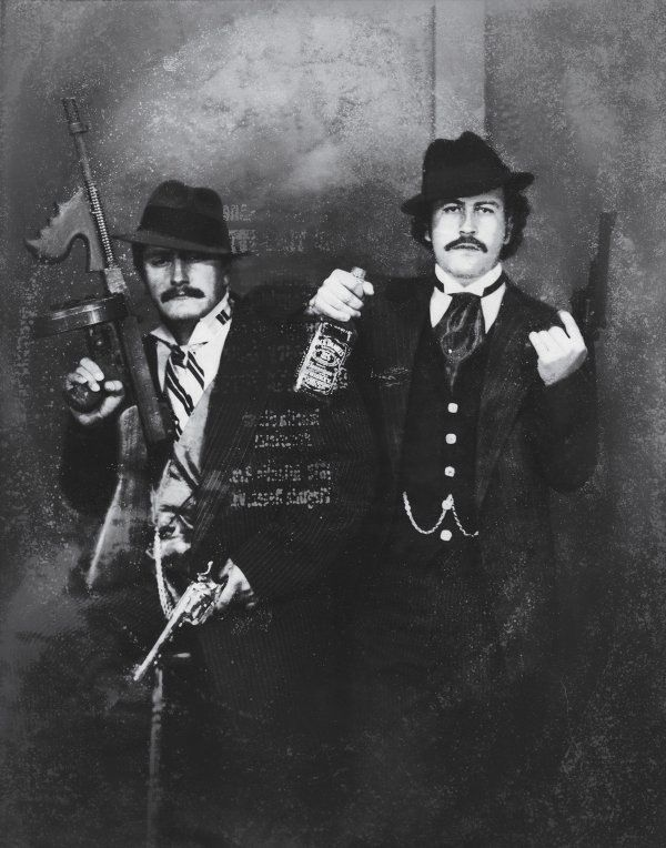 Pablo Escobar (to the right) posing as a gangster with his cousin Gustavo in the 1980s. : OldSchoolCool