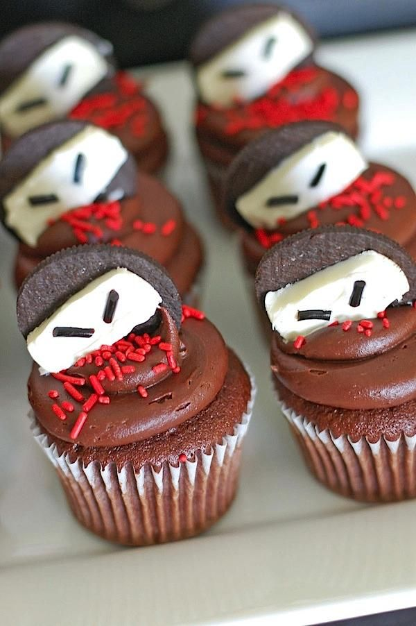 Ninja cupcakes using oreo cookies and licorice for eyes. Totally making these!