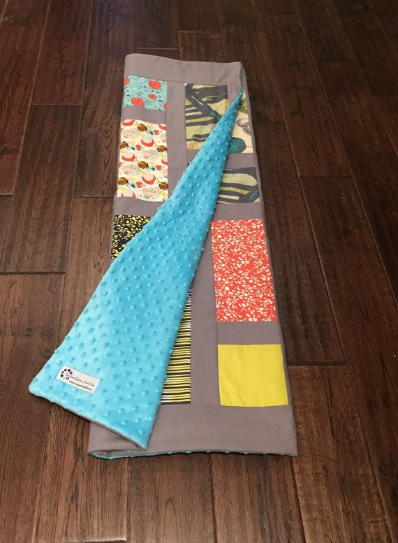 Beautiful modern baby quilt. Coral Aqua and grey modern baby quilt. Perfect for grey baby nursery.