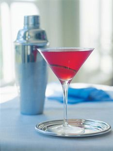Pomegranate Cosmopolitans  2 cups good vodka, such as Grey Goose or Finlandia   1 cup Cointreau liqueur   1 cup cranberry juice cocktail, such as Ocean Spray   ½ cup Pom Wonderful bottled pomegranate juice   ½ cup freshly squeezed lime juice (4 limes)   Thinly sliced limes, for garnish