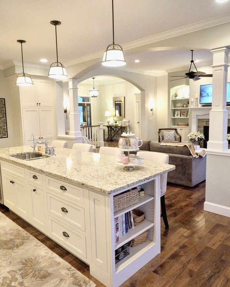 White kitchen, off-white cabinets, Sherwin Williams Conservative Gray, Venetian Gold Light Granite, open layout, open floor plan, open concept, hickory wood floors