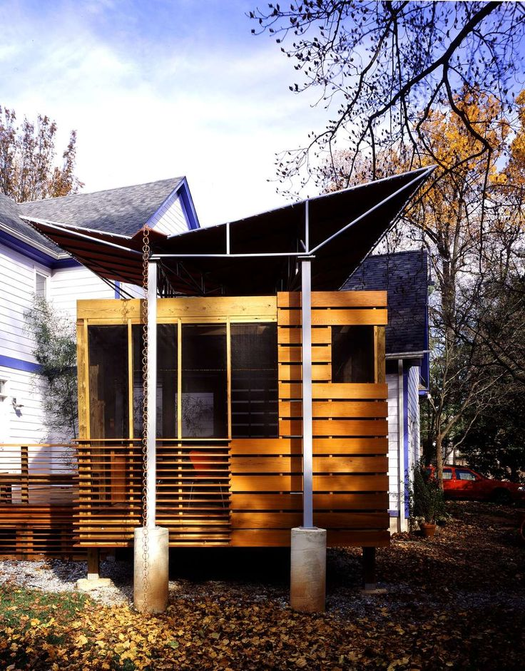 A modern porch in a quiet suburban Maryland neighborhood provides seasonal shelter for this family. Unlike traditional porches, this porch pulls away from t...