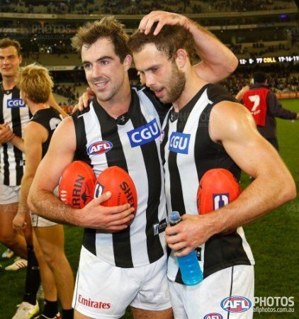 Steele Sidebottom of the Magpies (left) and Brent Macaffer of the Magpies celebrate during the 2013 AFL Round 15 match between the Carlton Blues and the Collingwood Magpies at the MCG, Melbourne on July 05, 2013. (Photo: Michael Willson/AFL Media)
