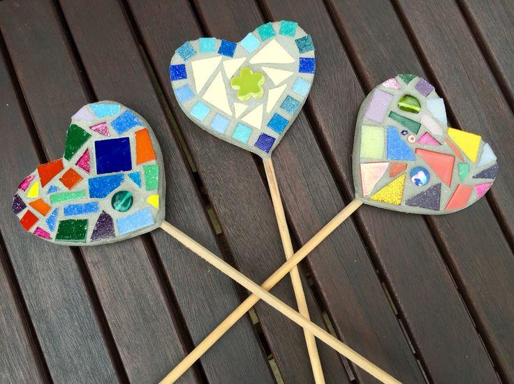 Trio of colourful handmade mosaic heart plant pot sticks.