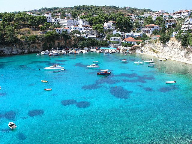 Alonnisos is a Greek island in the Aegean Sea member of the Northern Sporades. In this photo are shown the stunning blue waters from Votsi Harbour. The island and the villages were heavily damaged in the 1965 earthquake.