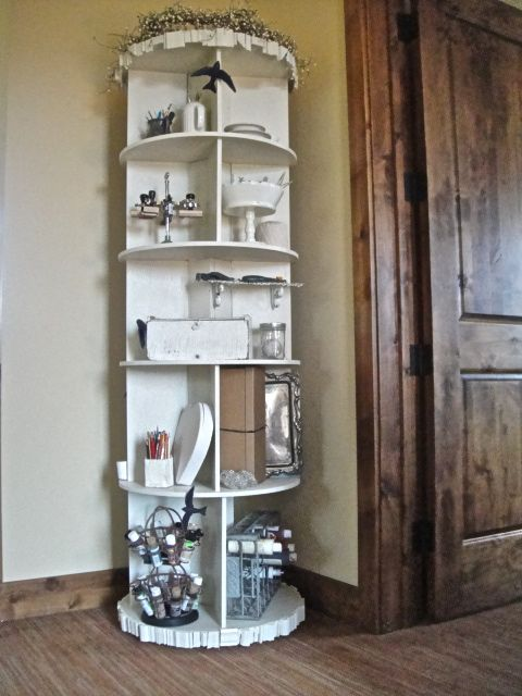 Revolving Bookcase for craft room storage.  Great tutorial for drilling the Lazy Susan mechanism.