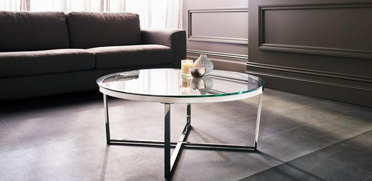 Coffee and Lamp tables with a thick 8mm tempered clear glass top, on a stainless…