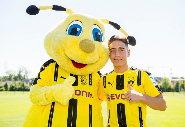 Dortmund's Emre Mor poses during with mascot Emma at the team presentation of Borussia Dortmund on August 17 2016 in Dortmund Germany