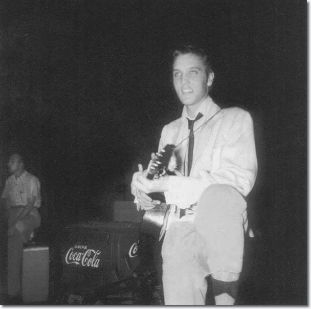 "Elvis Presley - Backstage at the Overton Park Shell, Friday, July 30, 1954. Elvis was so nervous he stood up on the balls of his feet and shook his leg in time with the music.  The young girls in the audience went crazy, yelling and applauding. Scotty said, ""We didn't know what was going on when all those people started screaming and hollering."""