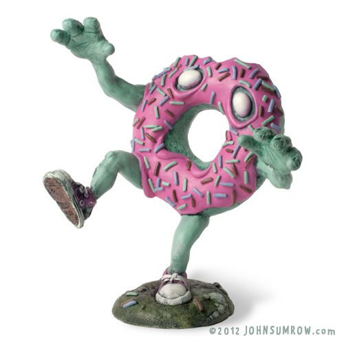 """Mr. Jimmies"" the Undead Doughnut or ""Zoughnut"" is a limited edition, hand painted, cast resin sculpture created by John Sumrow, an artist based in Albuquerque NM."