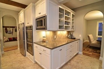 This is what our kitchen would look like with white cabinets. Tropical brown granite and similar backsplash.