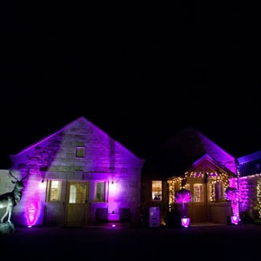 Outdoor party lighting - wedding venue lighting - pink lighting - country venue - Heaton House Farm