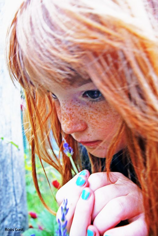 Redhead girl with flower