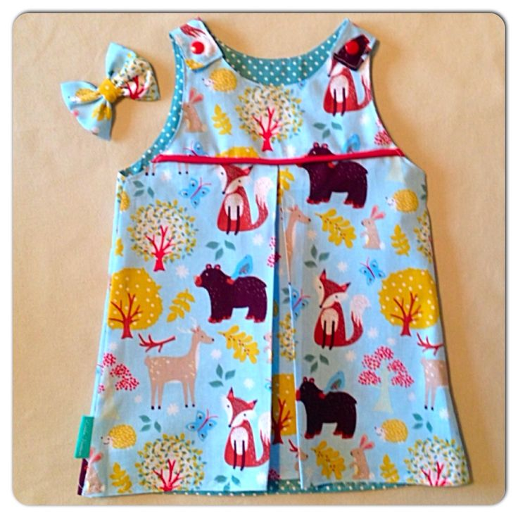 'Wonderful woodland' pinafore with piping and centre pleat. Fully lined and 100% cotton. Www.facebook.com/SewCraft-tastic
