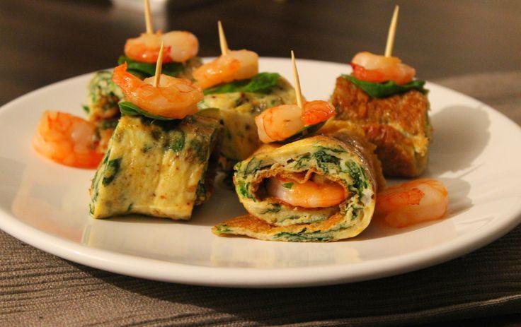 """Een gerecht dat moeilijk kan mislukken – op aanbranden na – is toch wel een omelet. Eieren in een roerkom, loskloppen, wat peper en zout erbij en hup, de pan in! Ook leuk: uit eiwitten haal je veel energie dus is een omelet ideaal voor de lunch of als work-out-... <a href=""""http://cottonandcream.nl/omeletrolletjes-met-spinazie-en-gambas/"""">Read More →</a>"""