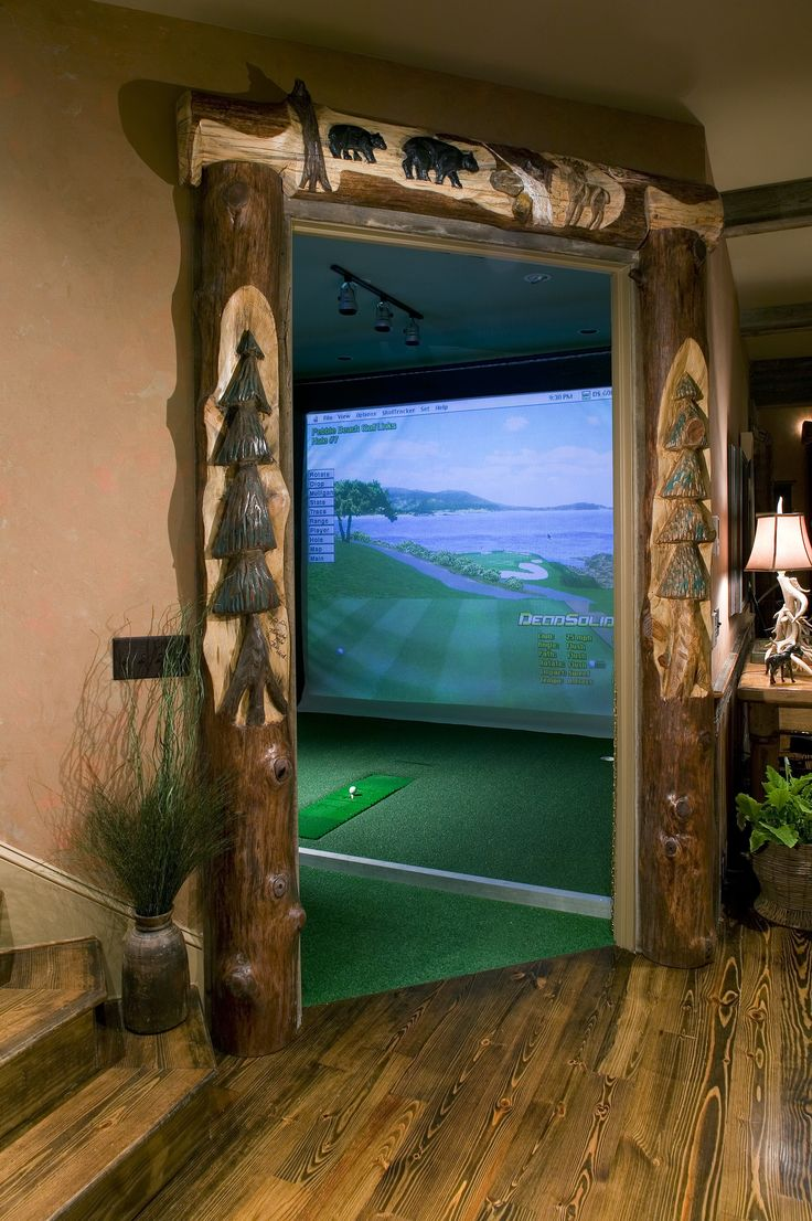 In door golf was made for the man cave. It goes perfectly in this rustic home with the dark wood stairs, large projector screen, rustic door frame and wall-mounted back lights. We should have included gaming in our list of man cave essentials.