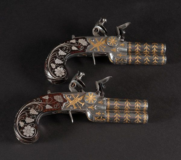 Possibly the Finest Pair of English Gold and Silver Inlaid Flintlock Over and Under Pocket Pistols on the market today. This and more important arms and armor for sale on CuratorsEye.com
