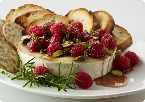 Warm Brie with Honeyed Raspberries and Pistachios..love me some baked brie- no recipe included