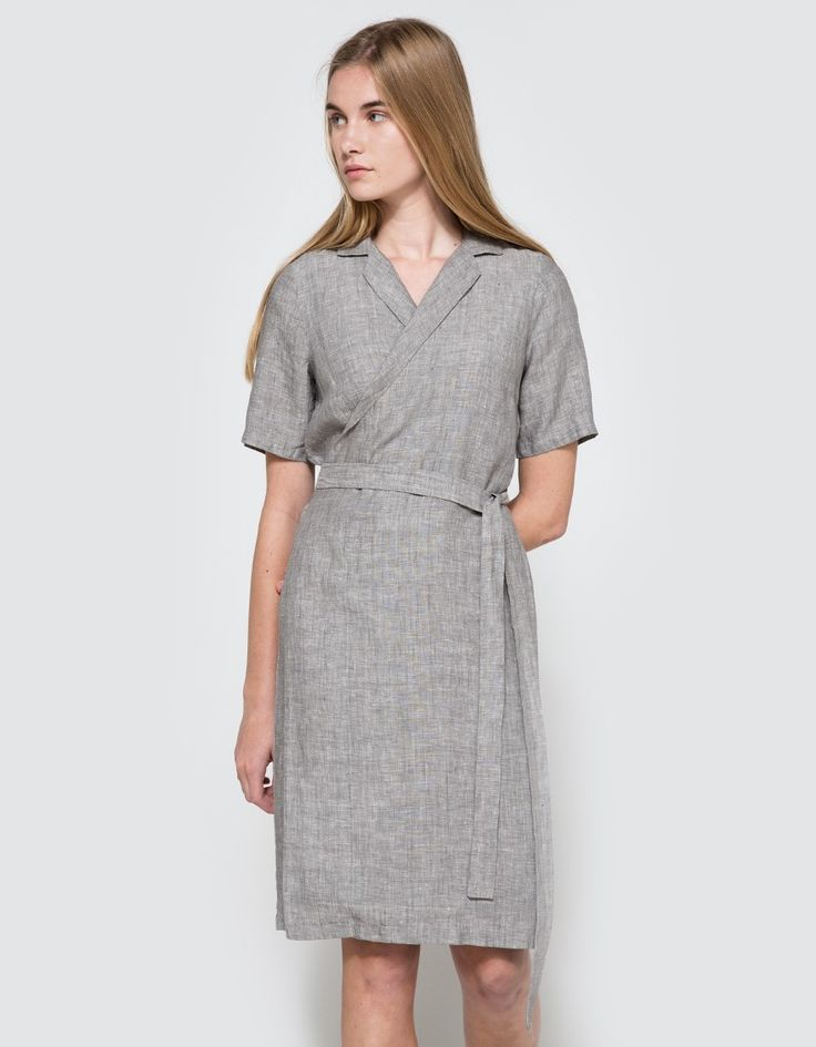 From Just Female, a wrap shirt dress in grey. Features notch lapel collar, short sleeves, darts from back neckline, wrap front, belt loops, coordinating waist tie, darts at bust, semi-opaque fabric and a casual fit.   •Wrap shirt dress in grey •Notch