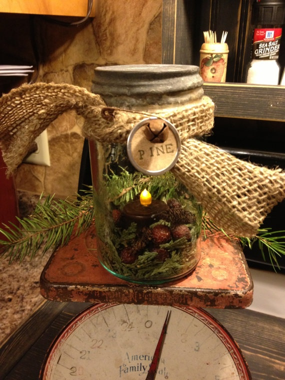 Old Mason Jar...stuffed with a prim candle, rosehips & pine... on a rusty scale.  By KelsCountryBlessings.