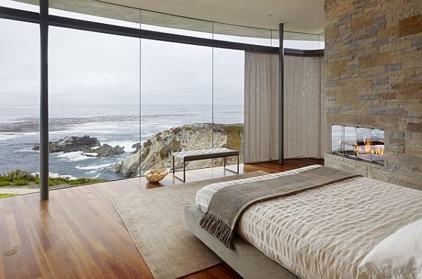 Now this is a view I would love to wake up to every morning. Love the stone wall and fireplace too.: