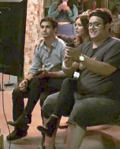 """Katharine McPhee with arm around Real Life Lover Elyes Gabel and Elyes with arm on Katharine leg > while watching Scorpion Season 2 Premiere """"Satellite of Love"""". Also pictured Ari Stidham"""