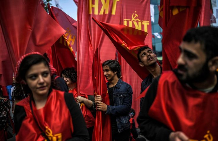 Istanbul, Turkey  People march with the red flags of the Turkish Communist party Photograph: Bulent Kilic/AFP/Getty Images