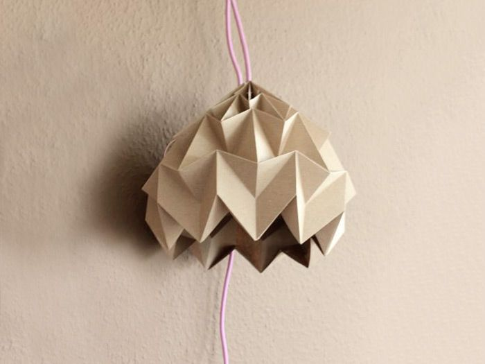 Using art paper and the amazing 'Magic Ball' Origami folding technique, she creates a beautiful hanging lantern.