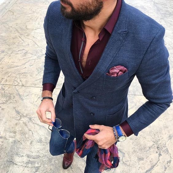 This combination of a navy wool double breasted blazer and blue slim jeans is…