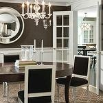 dining rooms - square back French dining chairs oval dining table acrylic chandelier wainscoting chocolate brown wallpaper French doors  White